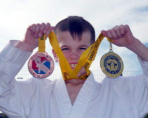 Orion holding gold and silver medals